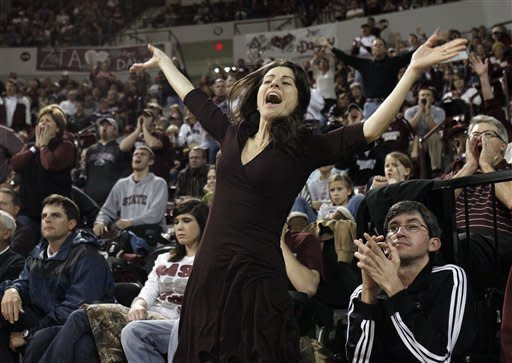 Meo Stansbury, wife of Mississippi State basketball coach Rick Stansbury, shouts encouragement to her husband's players in the second half of their NCAA college basketball game agasint in Starkville, Miss., Saturday, Feb. 4, 2012. Mississippi State won 91-88. (AP Photo/Rogelio V. Solis)