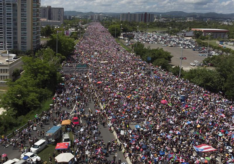 An aerial view from a drone shows thousands of people as they fill the Expreso Las Américas highway.