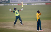 Pakistan's Hasan Ali, left, celebrates after playing a winning shot while South Africa's Andile Phehlukwayo, right, watches during the third Twenty20 cricket match between Pakistan and South Africa at the Gaddafi Stadium, in Lahore, Pakistan, Sunday, Feb. 14, 2021. (AP Photo/K.M. Chaudary)