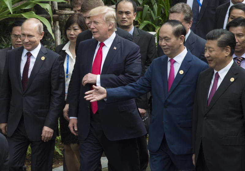 Left to right; Russian President Vladimir Putin, U.S. President Donald Trump, Vietnamese President Tran Dai Quang and Chinese President Xi Jinping walk to the group photo at the APEC Summit in Danang, Vietnam, Saturday, Nov. 11, 2017. (Adrian Wyld/The Canadian Press via AP)