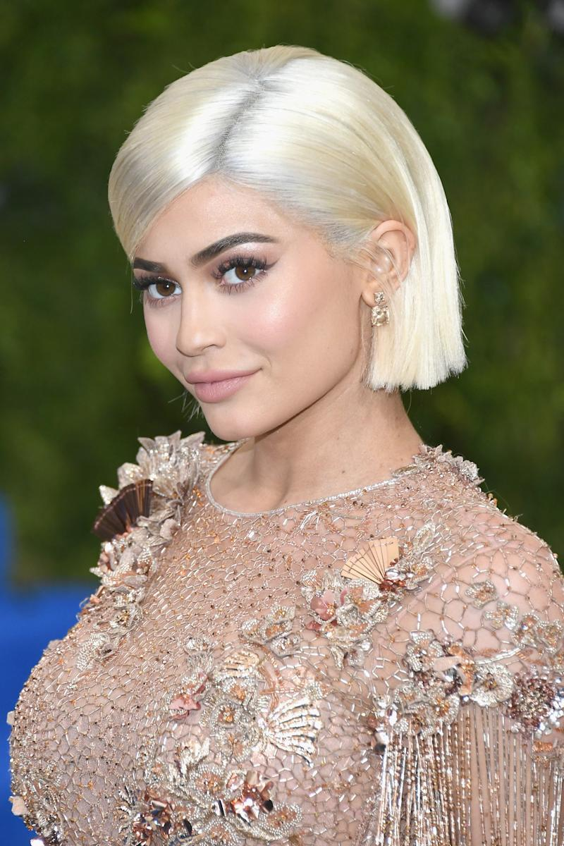 Back to platinum blonde, Jenner wears her ultra sleek bob with her signature neutral smokey eye and nude lip at the Costume Institute Gala.