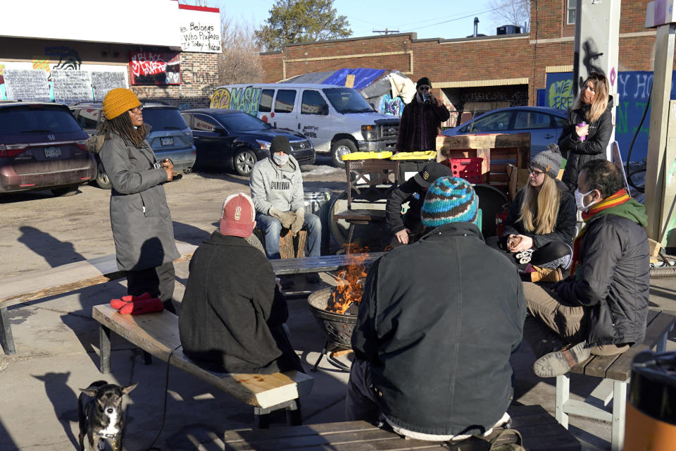 Marcia Howard, left, a group organizer, addresses activists and neighbors at George Floyd Square, March 4, 2021, in Minneapolis. Ten months after police officers brushed off George Floyd's moans for help on the street outside a south Minneapolis grocery, the square remains a makeshift memorial for Floyd who died at the hand of police making an arrest. The trial of former Minneapolis police officer Derek Chauvin will begin with jury selection on March 8. Howard took a leave from her teaching job to take up residence at the square. (AP Photo/Jim Mone)
