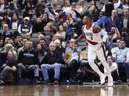 Dec 4, 2018; Dallas, TX, USA; Portland Trail Blazers guard Damian Lillard (0) reacts during the second half against the Dallas Mavericks at American Airlines Center. Mandatory Credit: Kevin Jairaj-USA TODAY Sports