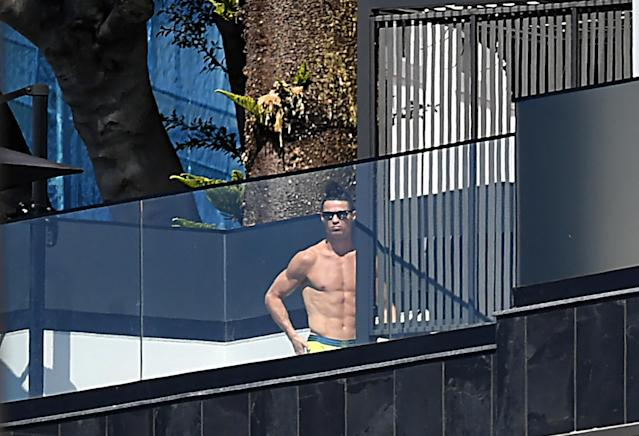 Juventus forward Cristiano Ronaldo sunbathes at his home in Funchal on March 16, 2020. Ronaldo has been in quarantine in Madeira for several days but is not showing any symptoms of the coronavirus contracted by Juventus teammates, local authorities in Portugal said. (Rui Silva/AFP)