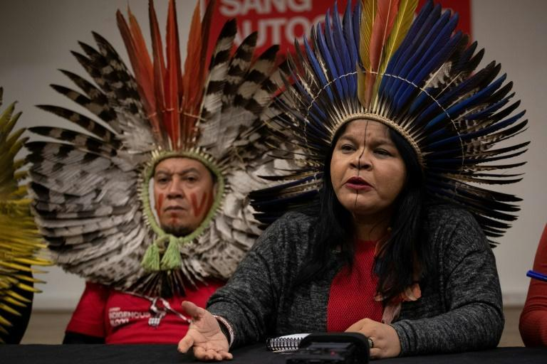 Brazilian indigenous leader Sonia Guajajara (R), seen at a news conference in Paris in 2019, says she is being investigated by police for allegedly 'slandering' the government over its coronavirus policies