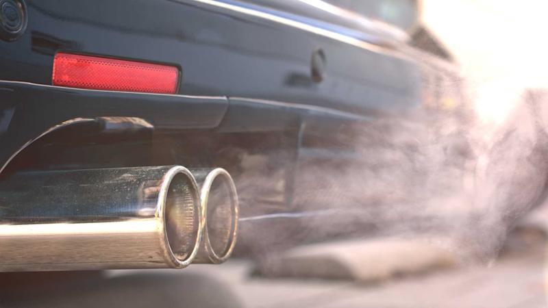Smoky dual exhaust pipes from starting diesel car