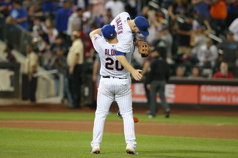Sep 28, 2019; New York City, NY, USA; New York Mets first baseman Pete Alonso (20) celebrates with third baseman Todd Frazier (21) after defeating the Atlanta Braves at Citi Field. Mandatory Credit: Brad Penner-USA TODAY Sports