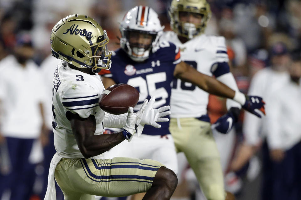 Akron wide receiver Michael Mathison (3) bobbles a punt reception during the second half of the team's NCAA college football game against Auburn on Saturday, Sept. 4, 2021, in Auburn, Ala. (AP Photo/Butch Dill)
