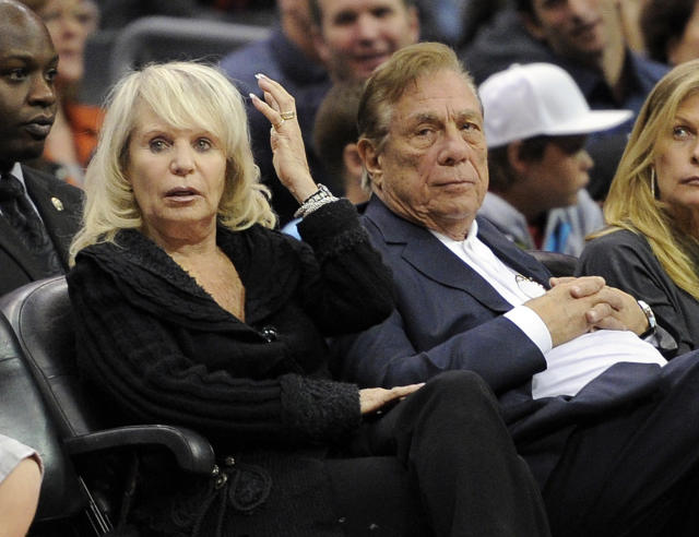 In this Nov. 12, 2010, file photo, Shelly Sterling sits with her husband, Donald Sterling, right, during the Los Angeles Clippers' NBA basketball game against the Detroit Pistons in Los Angeles. An individual with knowledge of negotiations to sell the Clippers says Shelly Sterling has reached an agreement to sell the team to former Microsoft CEO Steve Ballmer for $2 billion. The individual, who wasn't authorized to speak publicly, told The Associated Press on Thursday, May 29, 2014, that Ballmer and the Sterling Family Trust now have a binding agreement. The deal now must be presented to the NBA