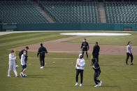 The Winthrop basketball team enjoys some outside activity at Victory Field for the NCAA college basketball tournament, Wednesday, March 17, 2021, in Indianapolis. (AP Photo/Darron Cummings)