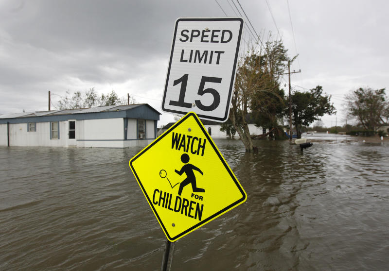 Homes are surrounded by flooded water seen after Isaac passed through the region, in Plaquemines Parish, La., Thursday, Aug. 30, 2012. Isaac staggered toward central Louisiana early Thursday, its weakening winds still potent enough to drive storm surge into portions of the coast and the River Parishes between New Orleans and Baton Rouge.(AP Photo/Gerald Herbert)
