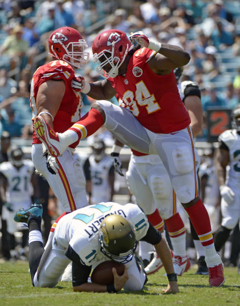 Kansas City Chiefs defensive end Tyson Jackson (94) celebrates after sacking Jacksonville Jaguars quarterback Blaine Gabbert (11) during the first half of an NFL football game in Jacksonville, Fla., Sunday, Sept. 8, 2013.(AP Photo/Phelan M. Ebenhack)