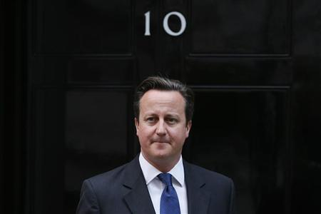 Britain's Prime Minister David Cameron waits to greet the President of the European Council, Van Rompuy, outside 10 Downing Street in central London