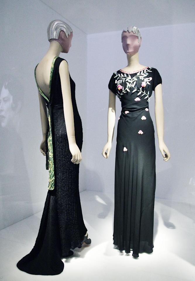 "Elsa Schiaparelli evening dresses from the 1930's are are on display at the Metropolitan Museum of Art, Monday, May 7, 2012 in New York. The show ""Schiaparelli and Prada, Impossible Conversations,"" opens May 10 and continues through Aug. 19. (AP Photo/Mark Lennihan)"
