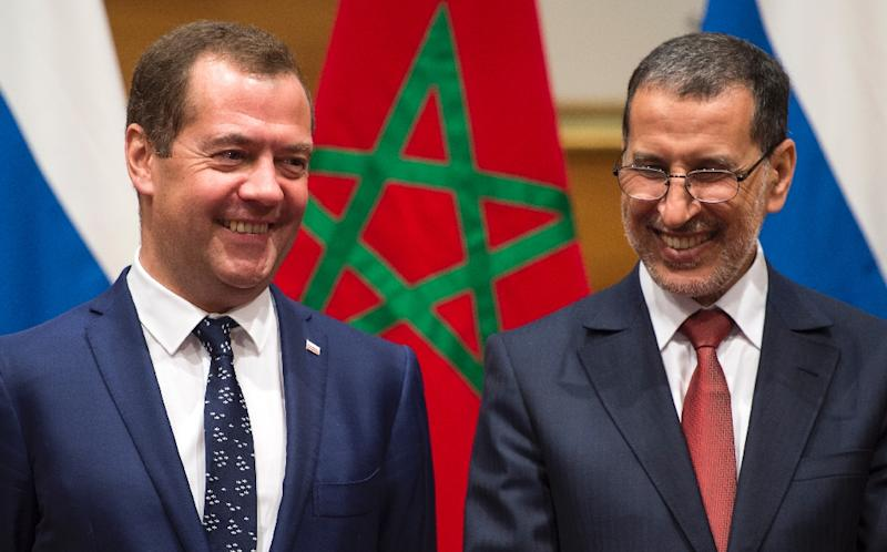 Morocco's Prime Minister Saadeddine El Othmani (R) meets his Russian counterpart Dmitri Medvedev in Rabat on October 11, 2017