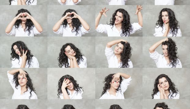 beautiful woman is making twenty different facial expressions