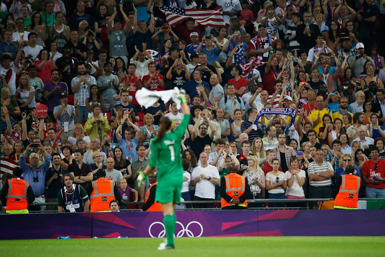 LONDON, ENGLAND - AUGUST 09:  Hope Solo #1 of the United States celebrates after defeating Japan by a score of 2-1 to win the Women's Football gold medal match on Day 13 of the London 2012 Olympic Games at Wembley Stadium on August 9, 2012 in London, England.  (Photo by Jamie Squire/Getty Images)