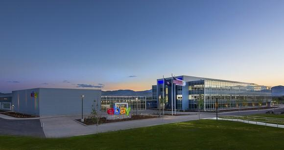 A modern eBay office with company logo on front lawn.