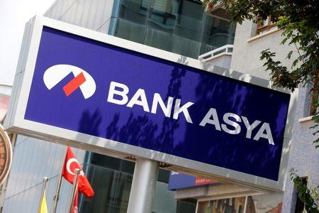 A Bank Asya logo is seen at a branch in Ankara
