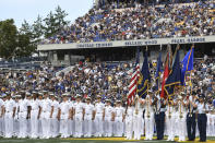 The Brigade of Midshipmen stand at attention during pre-game ceremonies before an NCAA college football game between Navy and Air Force, Saturday, Sept. 11, 2021, in Annapolis, Md. (AP Photo/Terrance Williams)