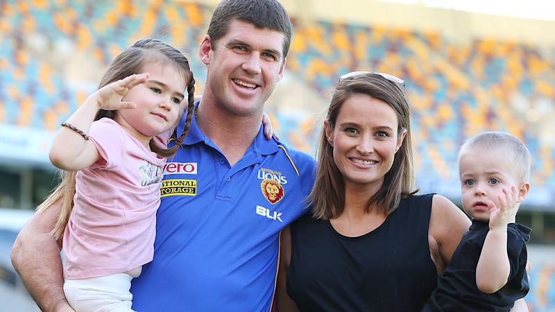 Jonathan Brown, pictured here with wife Kylie and children Olivia and Jack in 2014.