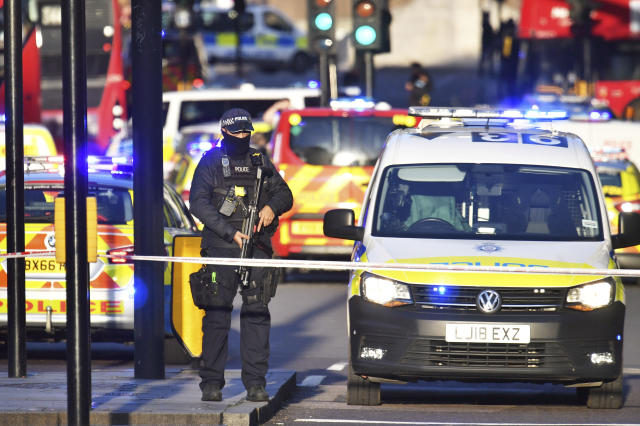 "Armed police at the scene of an incident on London Bridge in central London following a police incident, Friday, Nov. 29, 2019. British police said Friday they were dealing with an incident on London Bridge, and witnesses have reported hearing gunshots. The Metropolitan Police force tweeted that officers were ""in the early stages of dealing with an incident at London Bridge."" (Dominic Lipinski/PA via AP)"