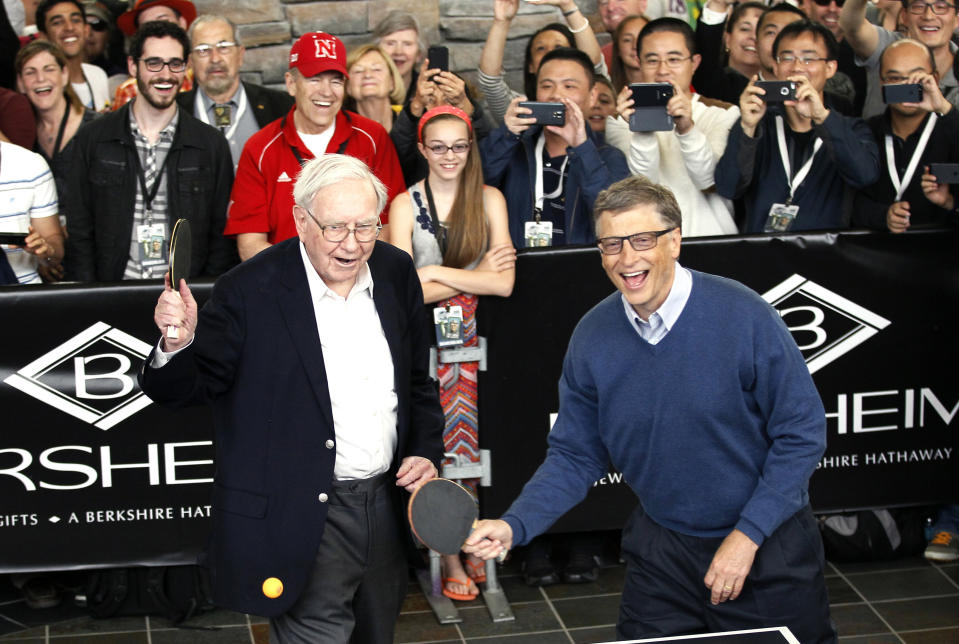 Berkshire Hathaway CEO Warren Buffett (L) and friend Bill Gates, founder of Microsoft, play table tennis at a Berkshire sponsored reception in Omaha, Nebraska May 4, 2014 as part of the company annual meeting weekend. The investment guru was peppered with questions at the meeting, part of a mostly festive weekend that Buffett calls
