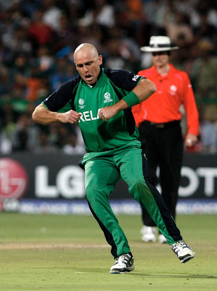 BANGALORE, INDIA - MARCH 06:  Trent Johnston of Ireland celebrates a caught and bowled from Virender Sehwag of India with a chicken dance in the Group B - 2011 ICC World Cup match between India and Ireland at M. Chinnaswamy Stadium on March 6, 2011 in Bangalore, India.  (Photo by Graham Crouch/Getty Images)