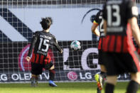 Frankfurt's Daichi Kamada scores the opening goal during the German Bundesliga soccer match between Eintracht Frankfurt and Bayern Munich in Frankfurt, Germany, Saturday, Feb. 20, 2021. (Arne Dedert/POOL via AP)