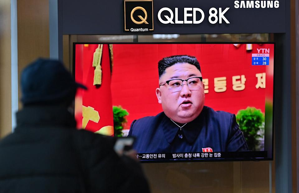 <p>A man watches a television screen showing news footage of North Korean leader Kim Jong Un attending the 8th congress of the ruling Workers' Party held in Pyongyang, at a railway station in Seoul on 6 January 2021</p> (AFP via Getty Images)