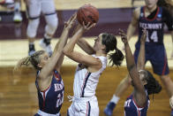 Gonzaga's Jenn Wirth, center, shoots over Belmont's Conley Chinn (20) during the first half of a college basketball game in the first round of the women's NCAA tournament at the University Events Center in San Marcos, Texas, Monday, March 22, 2021. (AP Photo/Chuck Burton)