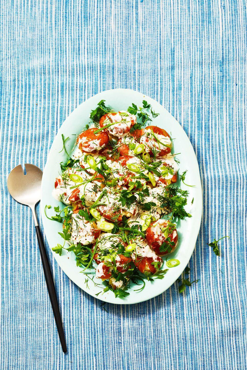 """<p>Bring this dreamy, creamy red potato salad to your next picnic and it might just outshine the main <a href=""""https://www.goodhousekeeping.com/food-recipes/g413/great-grilling-recipes/"""" rel=""""nofollow noopener"""" target=""""_blank"""" data-ylk=""""slk:grilling recipes"""" class=""""link rapid-noclick-resp"""">grilling recipes</a> on the table.</p><p><em><a href=""""https://www.goodhousekeeping.com/food-recipes/a36701641/red-potato-salad-recipe/"""" rel=""""nofollow noopener"""" target=""""_blank"""" data-ylk=""""slk:Get the recipe for Herby Red Potato Salad »"""" class=""""link rapid-noclick-resp"""">Get the recipe for Herby Red Potato Salad »</a></em></p>"""