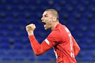 Burak Yilmaz was the star as Lille came from two goals down to win 3-2 at Lyon and stay on course for the French title