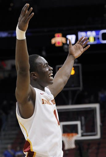 Iowa State guard Bubu Palo celebrates after a 77-64 win over Connecticut in an NCAA men's college basketball tournament second-round game in Louisville, Ky., Thursday, March 15, 2012. (AP Photo/Dave Martin)