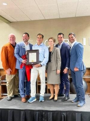 Coral Gables and Miami Mayors celebrate the opening of the nation's first healthy lifestyle community in Coral Gables, Fla. (Left to right: Coral Gables Speaker of the House Mark Trowbridge, director of the life of Coral Gables Gino Santia, life Time CEO Bahram Akradi, Coral Gables commissioner Rhonda Anderson, Coral Gables mayor Vince Lago, Miami mayor Francis Suarez.
