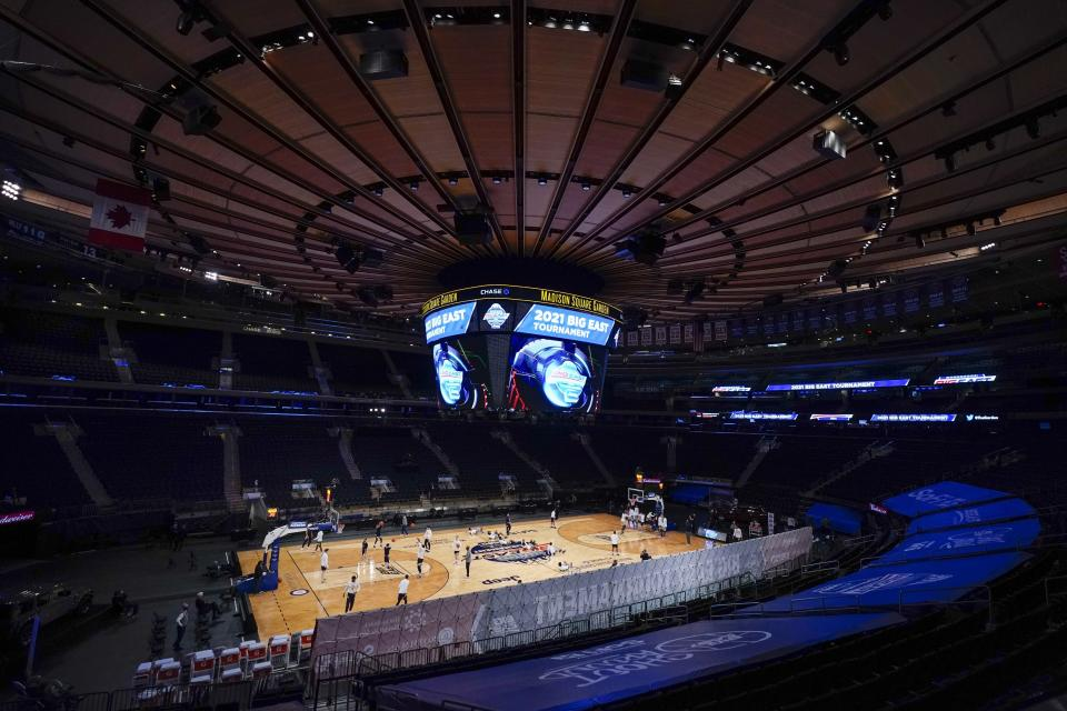 This is an overall showing Madison Square Garden before an NCAA college basketball game in the Big East conference tournament between Georgetown and Marquette Wednesday, March 10, 2021, in New York. Large buildings with high ceilings and ventilation systems that can change out fresh air almost a third as well as airplanes are reasons why experts and engineers believe it's reasonable for limited numbers of fans to be returning to live, indoor sporting events. (AP Photo/Frank Franklin II)