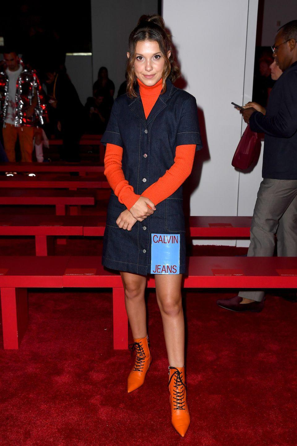 <p>A ribbed turtleneck paired with a short-sleeve dress is a trademark styling trick from the 1970s, but thanks to Millie's neon boots, it feels so trendy. </p>
