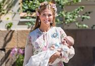 "<p>When Princess Madeleine and Chris O'Neill of Sweden welcomed the newest member of the family, Adrienne, they celebrated her baptism in style. The latest Swedish royal, who's tenth in line to the throne, wore the same gown as every royal infant born since 1906. The secret? The lining of the fabric is embroidered with the names of all the previous royal babies who wore it, according to <em><a href=""https://people.com/royals/princess-adriennes-christening-portraits-released/"" rel=""nofollow noopener"" target=""_blank"" data-ylk=""slk:People"" class=""link rapid-noclick-resp"">People</a>.</em> </p>"
