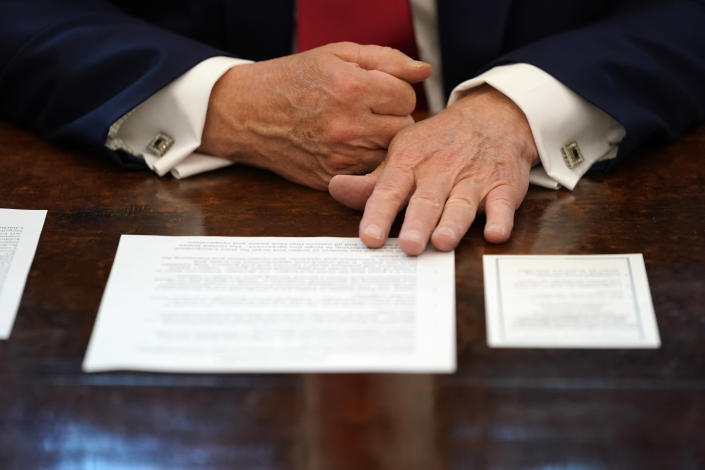 President Donald Trump listens while on a phone call with the leaders of Sudan and Israel, in the Oval Office of the White House, Friday, Oct. 23, 2020, in Washington. (AP Photo/Alex Brandon)