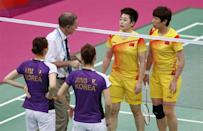 """The World Badminton Federation charged eight female players with misconduct on August 1, 2012 after four Olympic doubles teams had attempted to """"throw"""" matches to secure a more favorable draw later in the tournament. Tournament referee Torsten Berg (2nd L) speaks to players from China and South Korea during their women's doubles group play stage Group A badminton match during the London 2012 Olympic Games at the Wembley Arena July 31, 2012."""