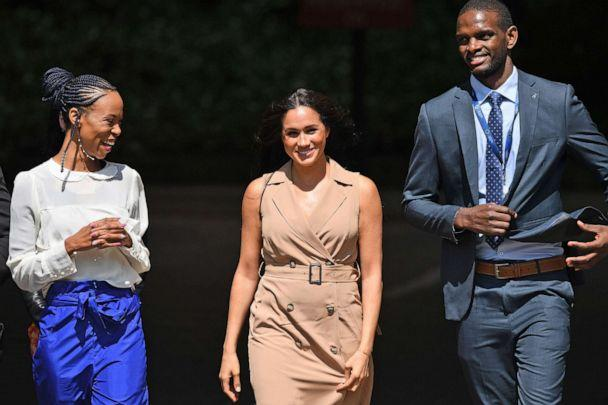 PHOTO: Meghan, the Duchess of Sussex, center, is accompanied by two unidentified officials during a visit to the University of Johannesburg, in Johannesburg, South Africa, Oct. 1, 2019. (Facundo Arrizabalaga/EPA via Shutterstock)