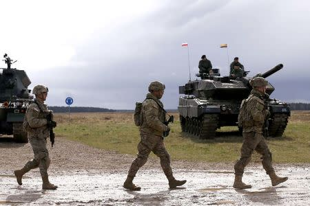 U.S. soldiers arrive to the welcoming ceremony at polygon near Orzysz