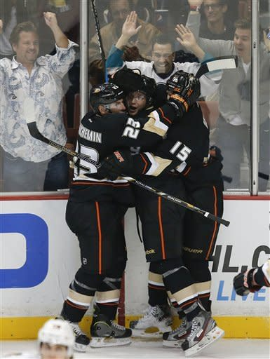Anaheim Ducks' Bobby Ryan, center, celebrates his goal with Francois Beauchemin, left, and Ryan Getzlaf during the third period of an NHL hockey game against the Chicago Blackhawks in Anaheim, Calif., Wednesday, March 20, 2013. The Ducks won 4-2. (AP Photo/Jae C. Hong)