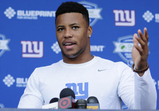 New York Giants running back Saquon Barkley speaks at a news conference at NFL football rookie camp, Friday, May 11, 2018, in East Rutherford, N.J. (AP Photo/Frank Franklin II)