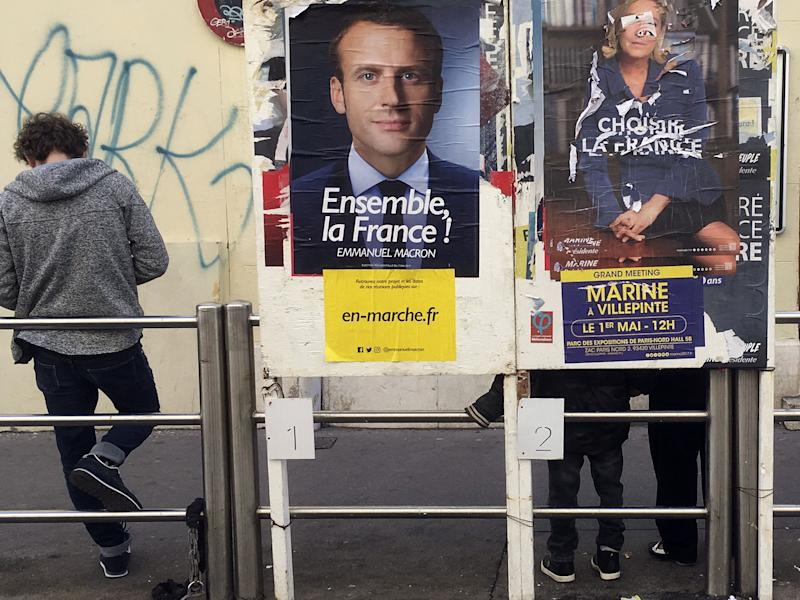 Macron still holds a commanding lead in the polls - but there are growing indications the election could be much closer most think: AP