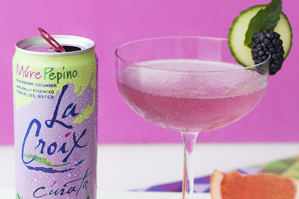 """<p>LaCroix's Cúrate Muré Pepino is a blackberry and cucumber-flavored sparkling water that can be made even more refreshing by adding fresh blackberries and mint leaves to a glass.</p> <p><a href=""""https://www.thedailymeal.com/recipes/blackberry-mint-smash-mocktail-lacroix?referrer=yahoo&category=beauty_food&include_utm=1&utm_medium=referral&utm_source=yahoo&utm_campaign=feed"""" rel=""""nofollow noopener"""" target=""""_blank"""" data-ylk=""""slk:For the Blackberry Mint Smash recipe, click here."""" class=""""link rapid-noclick-resp"""">For the Blackberry Mint Smash recipe, click here.</a></p>"""