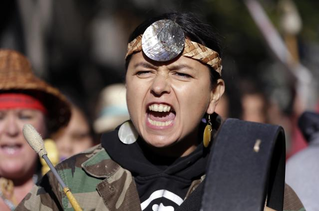 <p>A Native American woman drums and sings as she marches during an Indigenous Peoples Day event Monday, Oct. 9, 2017, in Seattle, Wash. (Photo: Elaine Thompson/AP) </p>
