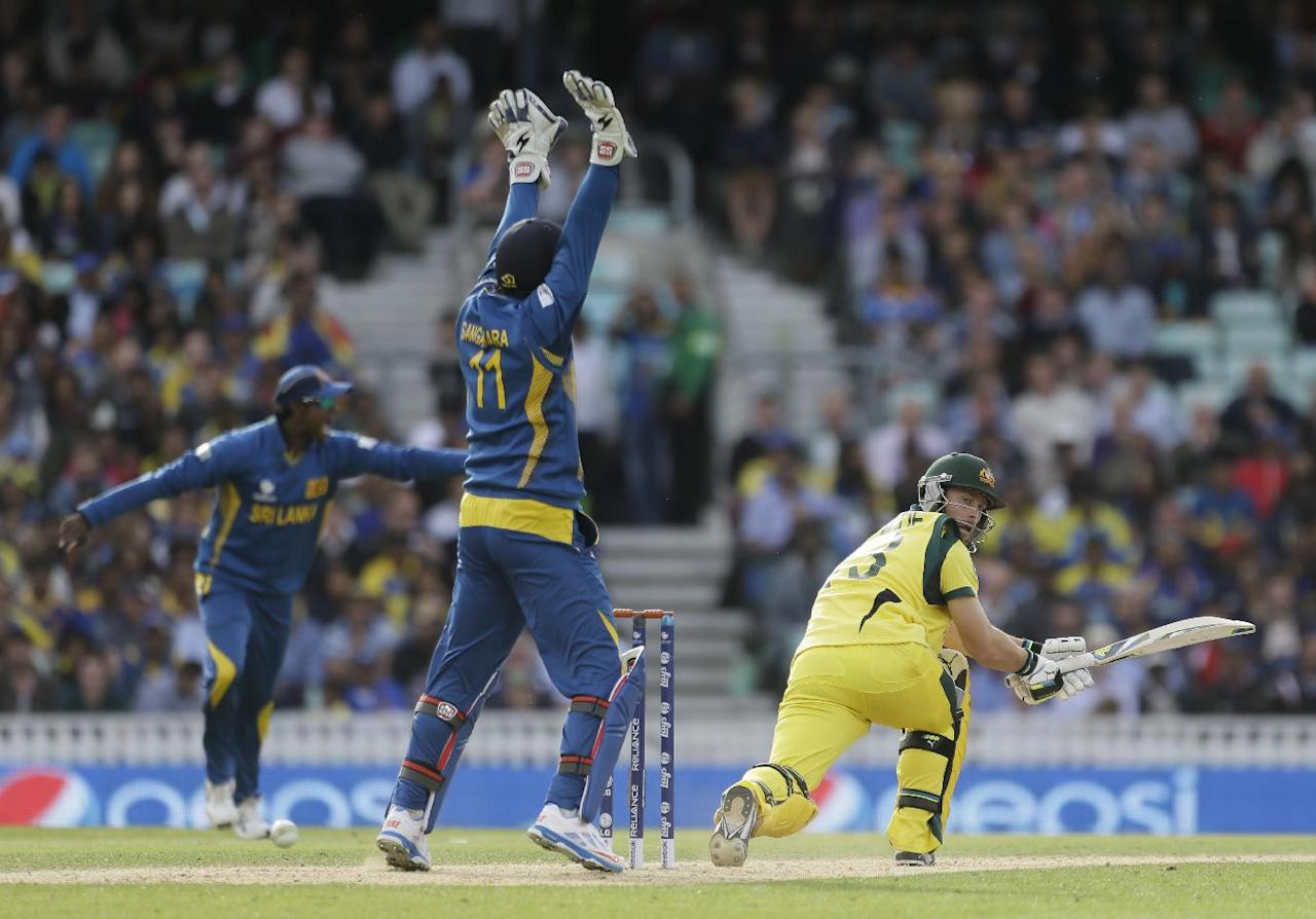 Australia's Matthew Wade looks round as Sri Lanka's Kumar Sangakkara appeals for lbw decision that went to a TV replay but was given not out during their ICC Champions Trophy cricket match at the Oval cricket ground in London, Monday, June 17, 2013. (AP Photo/Alastair Grant)