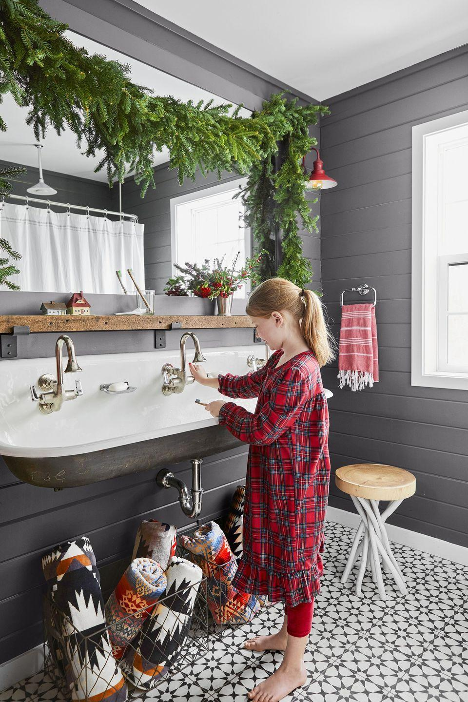 """<p>Add a <a href=""""https://www.countryliving.com/diy-crafts/g658/christmas-garlands-1208/"""" rel=""""nofollow noopener"""" target=""""_blank"""" data-ylk=""""slk:simple string of garland"""" class=""""link rapid-noclick-resp"""">simple string of garland</a> anywhere—yes, even in the bathroom!—to make every inch of your home merry and bright.</p><p><a class=""""link rapid-noclick-resp"""" href=""""https://www.amazon.com/Vickerman-Unlit-Camden-Fir-Garland/dp/B0029OL3H4?tag=syn-yahoo-20&ascsubtag=%5Bartid%7C10050.g.1247%5Bsrc%7Cyahoo-us"""" rel=""""nofollow noopener"""" target=""""_blank"""" data-ylk=""""slk:SHOP GARLAND"""">SHOP GARLAND</a></p>"""