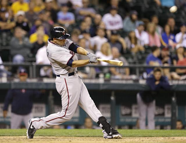 Minnesota Twins' Chris Colabello hits a two-run home run against the Seattle Mariners in the 13th inning of a baseball game Friday, July 26, 2013, in Seattle. (AP Photo/Elaine Thompson)
